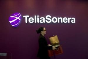 A woman walks past TeliaSonera's logo during the company's fourth quarter result presentation