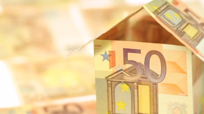 stock-footage-house-made-of-euros-pan-right